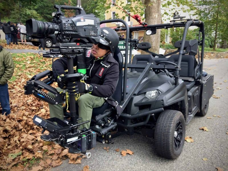 Steadicam operator in front seat of Scorpius